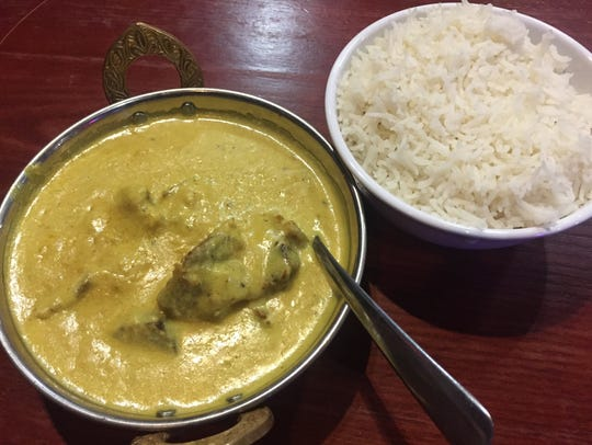 Butter lamb is creamy with mild spices, served over