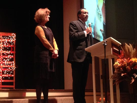 Pastor Emmanuel Simmons, pastor of All Nations Church, offered an opening prayer at Tuesday's gala, as Lisa Clements looks on.