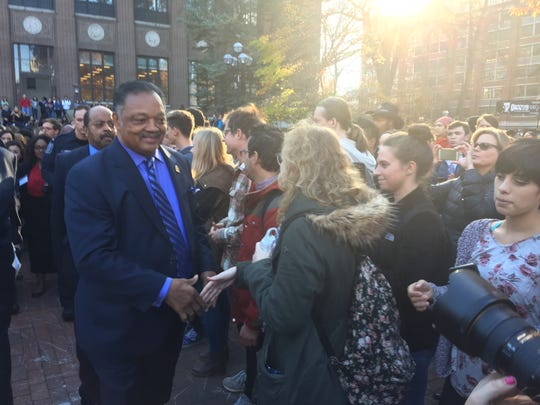 Jesse Jackson talks to students during an anti-Donald Trump rally at the University of Michigan in Ann Arbor.