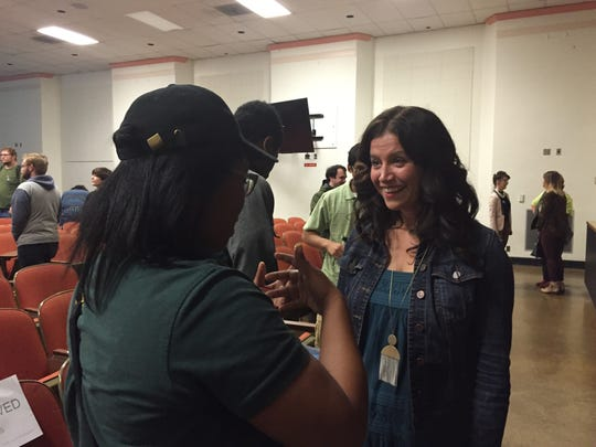 Amy Lawson Smeed, the co-head of animation for Disney's 'Moana,' talks to Eastern Michigan University junior Selena Johnson after a presentation on the animated film.The event at the Ypsilanti college was hosted by EMU's simulation, animation and gaming program..