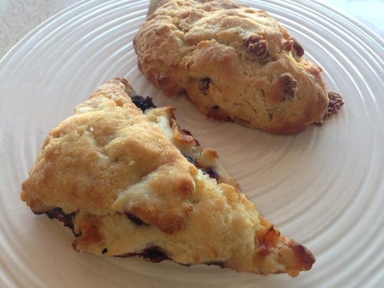 A blueberry scone and savory cheddar and sausage scone from Janie's Sweet Delights on Fort Myers Beach.