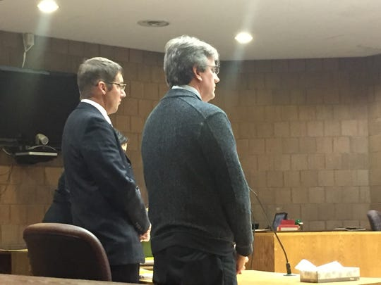 David Hovarter, right, stands with his attorney Timothy Williams during a court hearing Thursday, Nov. 17, 2016 in 55th District Court.
