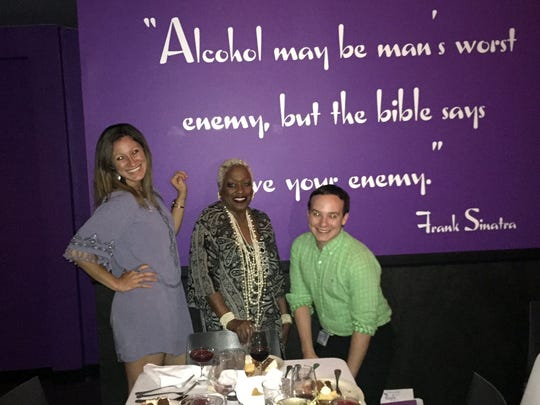 Left to right: Desert magazine editor Kristin Scharkey, Jazz singer Rose Mallett and food reporter Jose Bastidas at The Purple Room Supper Club