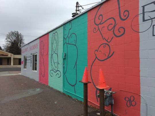 City Hall in 2016 ruled that wall art on the exterior of Elegant Mommy, 207 W 37th St., violated Sioux Falls signage rules because it tells passersby what's happening inside the building. But the business got its art in compliance with Sioux Falls ordinance by removing the text from the piece.