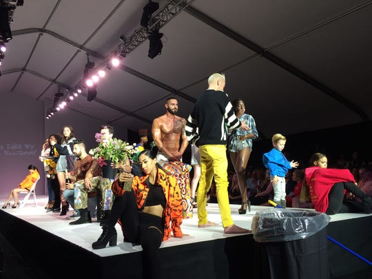 Models wearing Eddie Eddie by Billy Tommy act like mannequins on the runway during Style Fashion Week Palm Springs on Nov. 12, 2016.