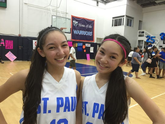 St. Paul Warriors Haley Senne, left, and Chloe Miranda were their team's top scorers during a game against the Okkodo Lady Bulldogs on Nov. 19 at their home gym.