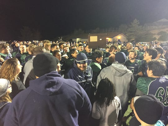 Damonte Ranch players and  fans celebrate Friday night after beating Reed, 49-45.