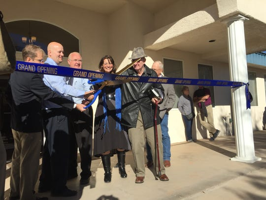 Washington County Public Library Director Joel Tucker, second from left, joins city, county and state officials in cutting the ribbon on Hildale's first public library Friday.