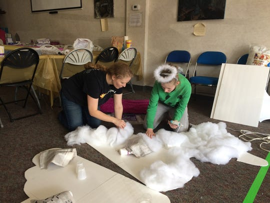 Vicki and Autumn Mackey work on making the clouds for their Redeeming Life Ministries's Staunton Christmas Parade float on Saturday, Nov. 19, 2016, in Staunton, Va.