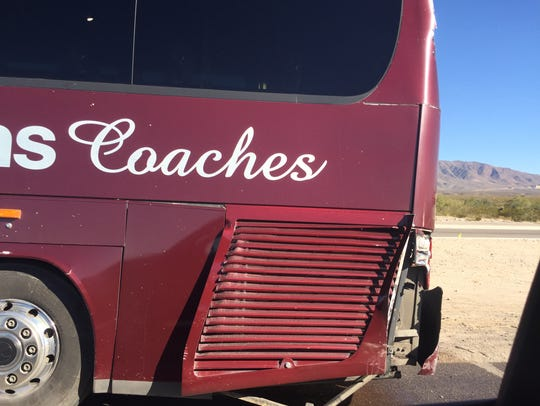 Damage to one one of the buses carrying members of
