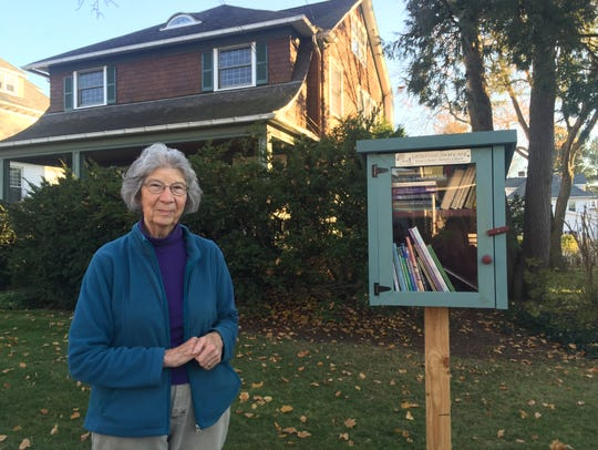 Ruth Levy stands outside her home on Bennett Avenue