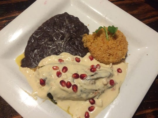Turkey-stuffed chile rellenos in a poblano cream sauce served at La Buena Vida Mexican restaurant in Fort Collins.