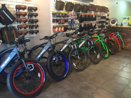A row of electric bikes inside the Pedego Palm Springs