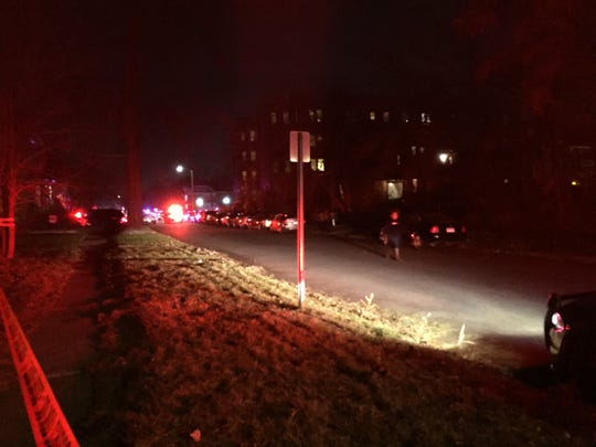 Police block the street at Brainard and Lincoln in Detroit Tuesday as they investigate the shooting of a Wayne State University police officer.