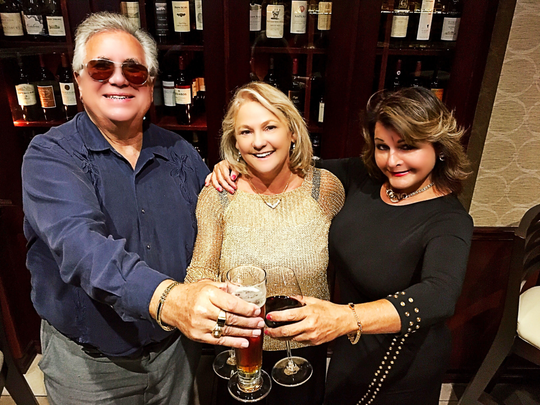 Happy birthday  Keith Laggos and Donna Winkler help Elizabeth Ingalls (center) celebrate her birthday at Tropicana Casino's Cavanugh's. Guests were asked to bring donations to PAWWS in lieu of gifts.