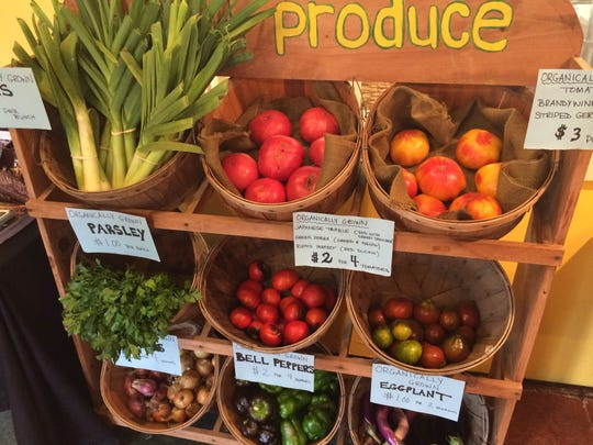 A colorful variety of local produce from Sprout Creek Farm is shown.