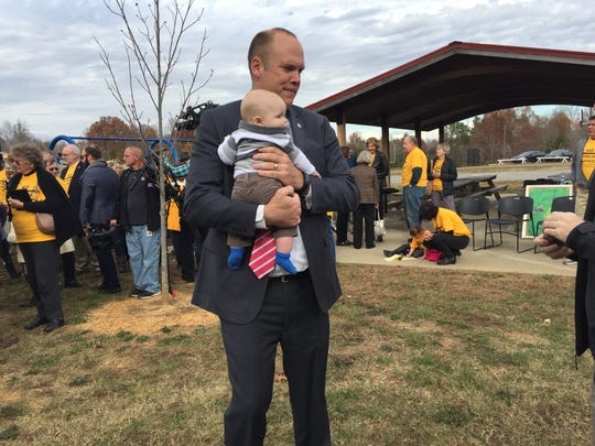 Metro Police Detective Mike Dixon holds his son at