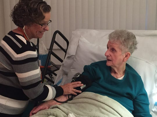 Catherine DiDonato, 83, gets a visit from Kathryn Corbet, a nurse practitioner with the Visiting Nurse Association Health Group, at her Toms River home.