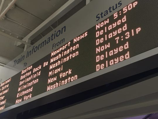 The information board at Wilmington's Joseph R. Biden Jr. Railroad Station shows delays of more than two hours for most Amtrak trains.