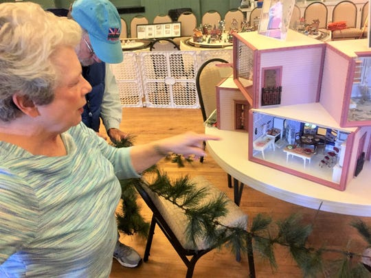 Bev Hardin shows off her house boxes, which feature