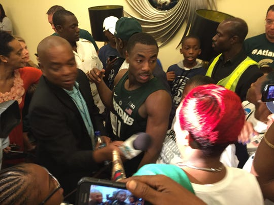 Michigan State guard Tum Tum Nairn joins a crowd of his family and fans after MSU's win Wednesday in Nassau, Bahamas.