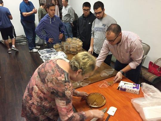 Meals on Wheels volunteer Karen Graves packs up pumpkin