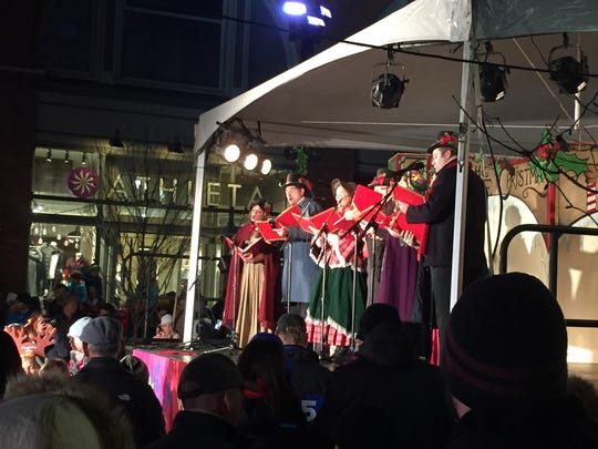 Performers with Bag O'Chips Productions sing carols Friday night as part of Burlington's Christmas Tree lighting festivities. Photographed Nov. 25, 2016.