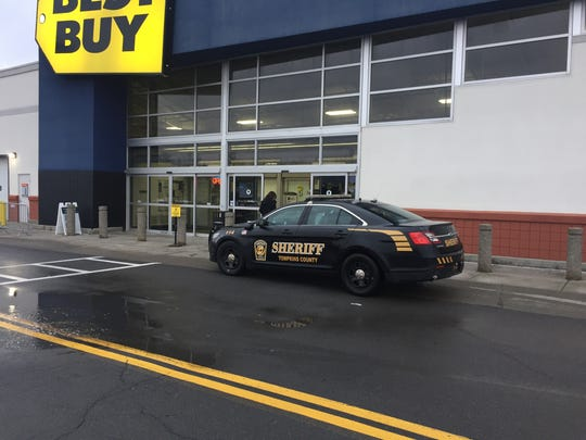 Customers walk into Best Buy at the the Shops at Ithaca Mall at 8:05 a.m. on Friday. About 20 people were waiting in line for the doors to open at 8 a.m. A Tompkins County Sheriff's officer was present as a precautionary measure but no incidents were reported.