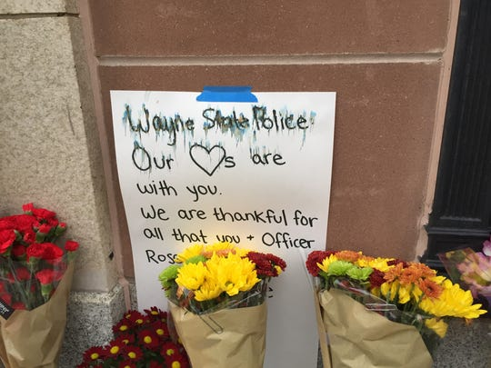 Outside the lobby of the Wayne State University campus police, mourners left flowers in memory of slain Officer Collin Rose.