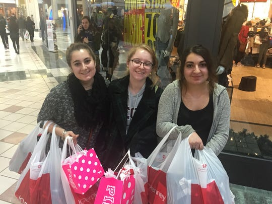 Juliana DiCecca, left with Megan Hamill, middle and sister Danielle shop at Eastview Mall on Black Friday. They began their day at 3 a.m.