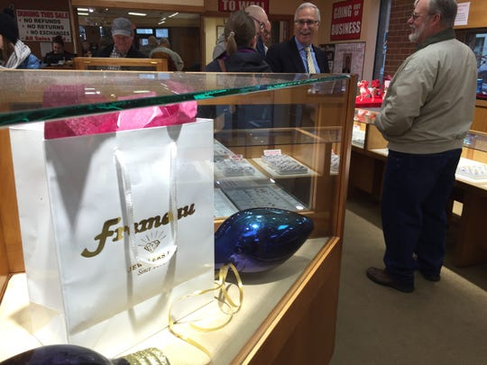 Kent Wood chats with customers Saturday at Fremeau Jewelers. The owner will soon close the store that opened in Burlington in 1840.