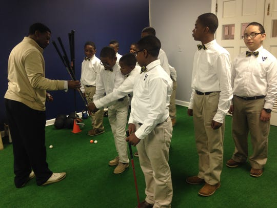 Scholars at Valiant Cross Academy learn golf from coach