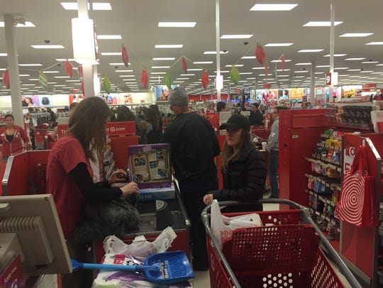 Sarah Pelusio checking out the sale on toys at Target
