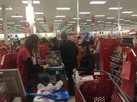 Sarah Pelusio checking out the sale on toys at Target in Victor on Black Friday