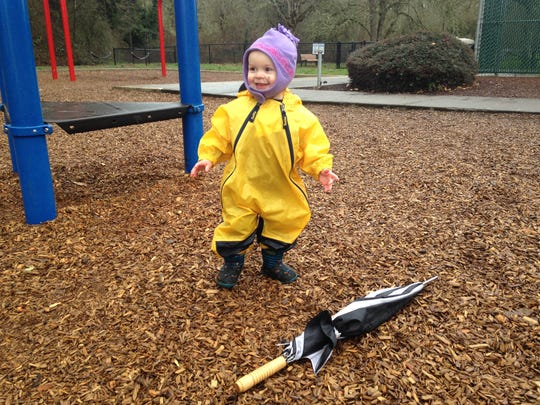 Lucy Urness wears her Muddy Buddy rain suit at Orchard Heights Park in Salem.