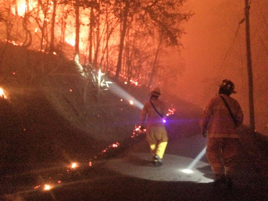 Oak Ridge Fire Capt. Jordon Alcorn, left, and firefighter