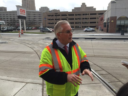 M-1 Rail Chief Operating Officer Paul Childs leads members of the media on a tour of Woodward Avenue near the Penske Tech Center in Detroit Thursday. Officials were celebrating the end of road construction for the QLINE streetcar.