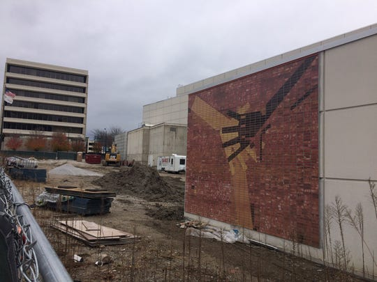 A mural has been installed on the exterior of the Wellmark YMCA. It is a recreation of a brick mosaic that adorned the now-demolished Riverfront YMCA.