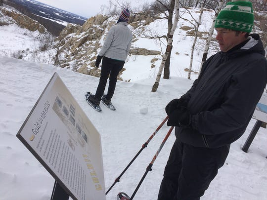 Snowshoers explore Rib Mountain.