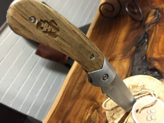 Tahoe Timber, based admittedly outside of Nevada, makes sunglasses and knives from Tahoe National Forest timber. This knife is $85. Sunglasses are anywhere from $75-$150 on TahoeTimber.com.
