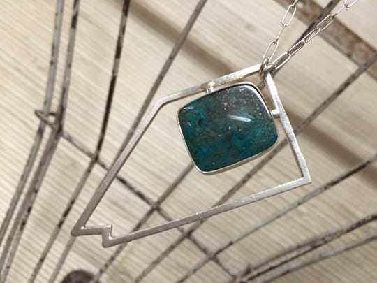 Katie Morrissey's silver and stone jewelry is a perfect gift for your favorite Silver State gal; stone embedded necklaces  are from $165 to $185.