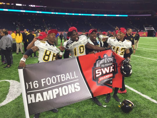 Grambling wide receiver Chad Williams, center, holds