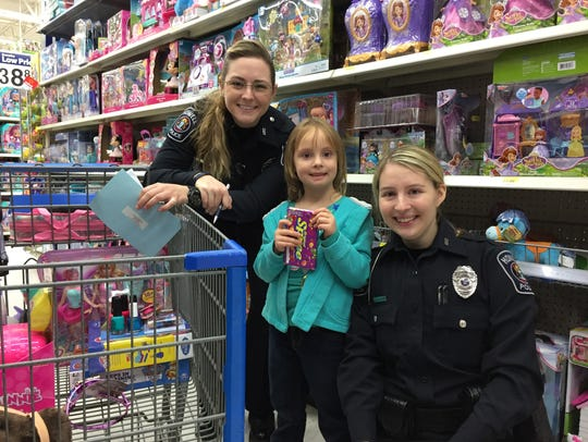 Howell Police Department officers Brooke Briggs (left)