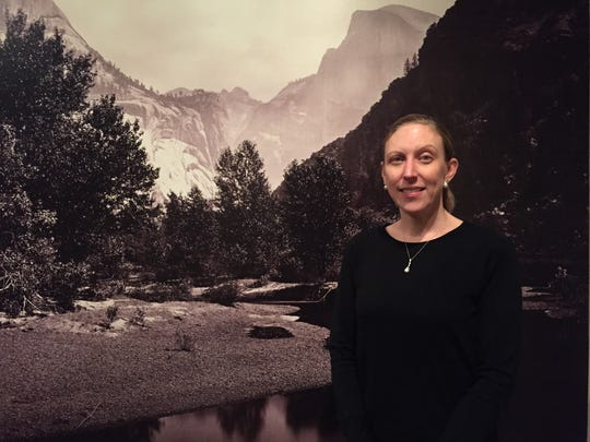 "Tamera Muente, installing curator of ""Picturing the West"" at the Taft Museum of Art"