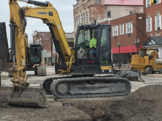 Speer Brothers digging into water and sewer line at the intersection of Madison and Perry Street.