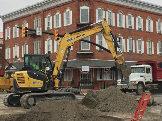 Speer Brothers crew begins sewer and water line separation