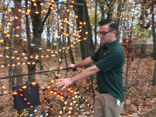 Garrett Hawk explains what goes into setting up Holiday Lights, including the stage coach display.
