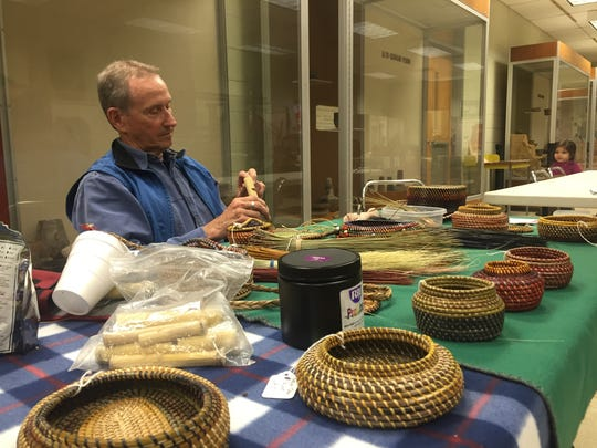 Charlie Viers works on pine needle basketry and crafts