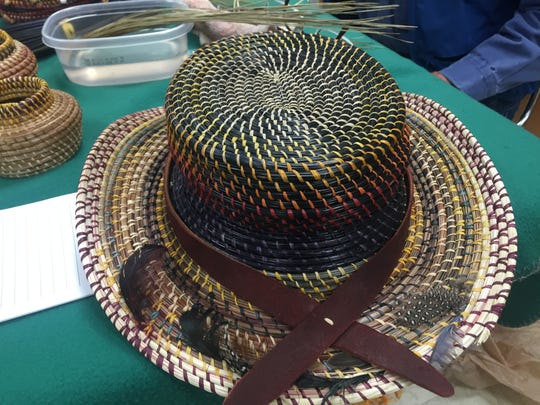 A hat made out of pine needles by artist Charlie Viers.