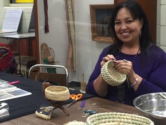 Houma artist Lora Ann Chaisson works on palmetto stitch